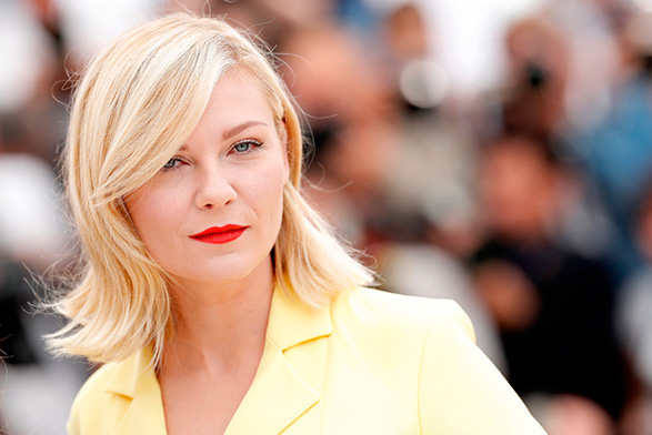 Kirsten-Dunst-went-retro-glam-sideswept-bang-paired