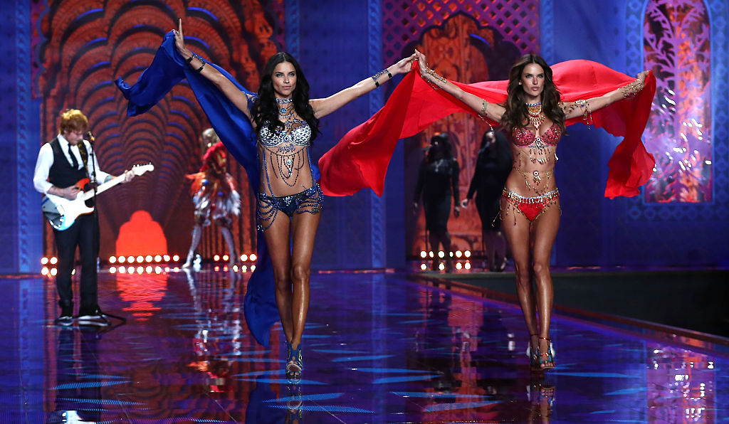 LONDON, ENGLAND - DECEMBER 02:  Adriana Lima (l) and Alessandra Ambrosio walk the runway at the annual Victoria's Secret fashion show at Earls Court on December 2, 2014 in London, England.  (Photo by Tim P. Whitby/Getty Images)