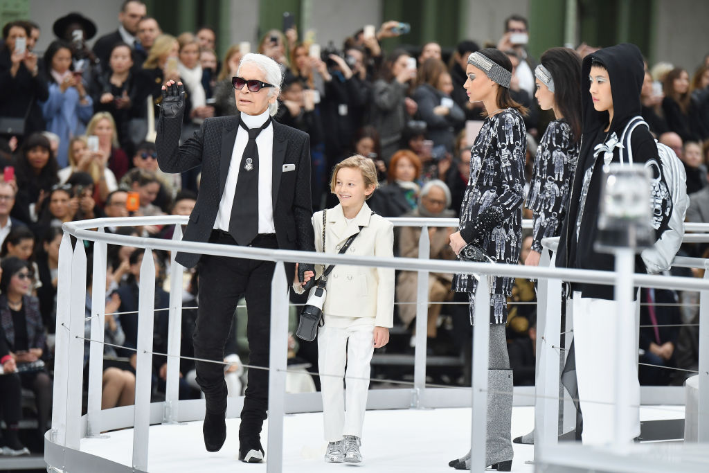 PARIS, FRANCE - MARCH 07:  Designer Karl Lagerfeld and his godson Hudson Kroenig are seen on the runway during the finale of the Chanel show as part of the Paris Fashion Week Womenswear Fall/Winter 2017/2018 on March 7, 2017 in Paris, France.  (Photo by Pascal Le Segretain/Getty Images)