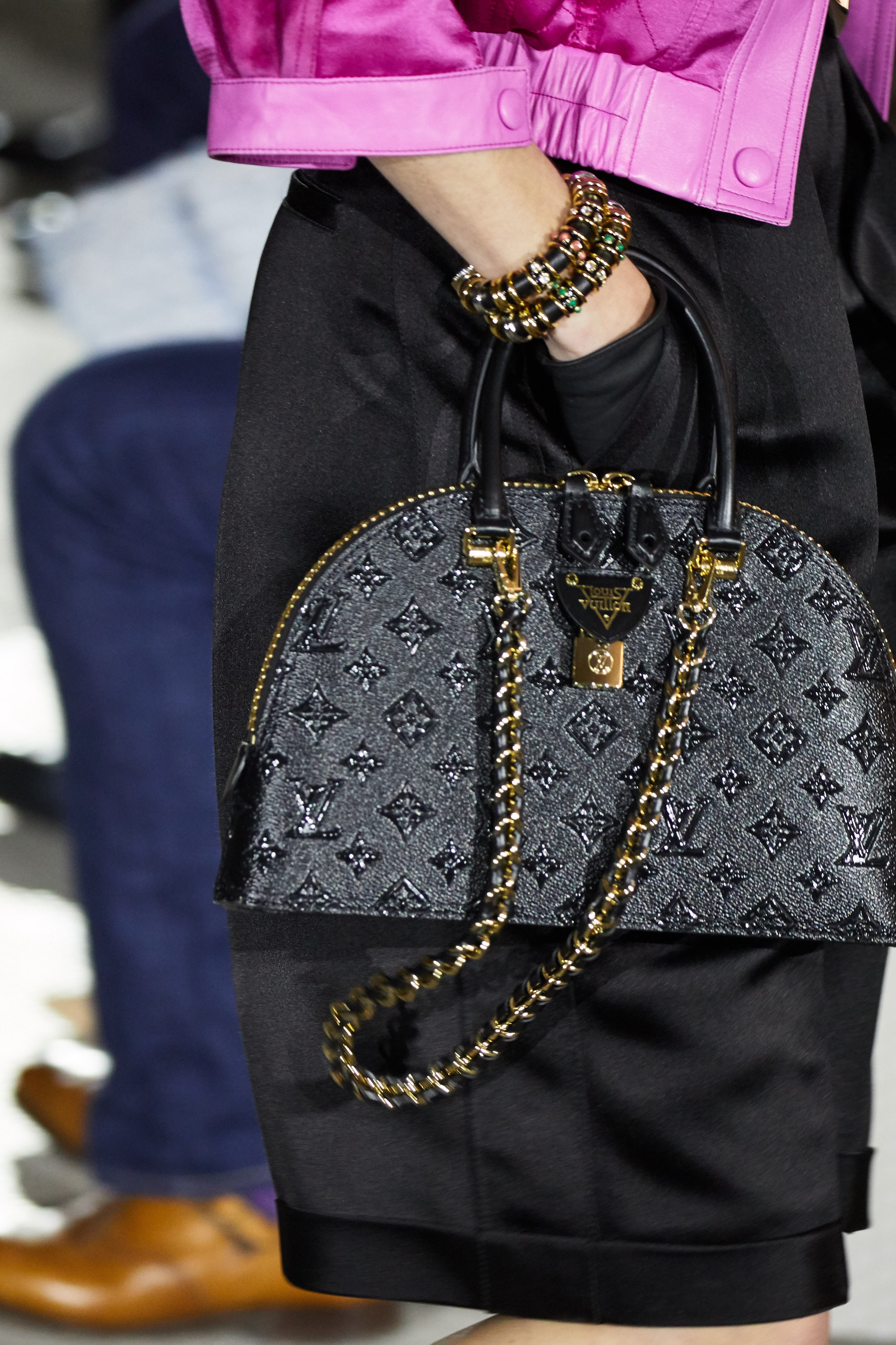 NEW YORK, NEW YORK - MAY 08: A model (bag detail) walks the runway wearing Louis Vuitton Cruise 2020 at the TWA Terminal Hotel at JFK on May 08, 2019 in New York City. (Photo by Thomas Concordia/Getty Images)