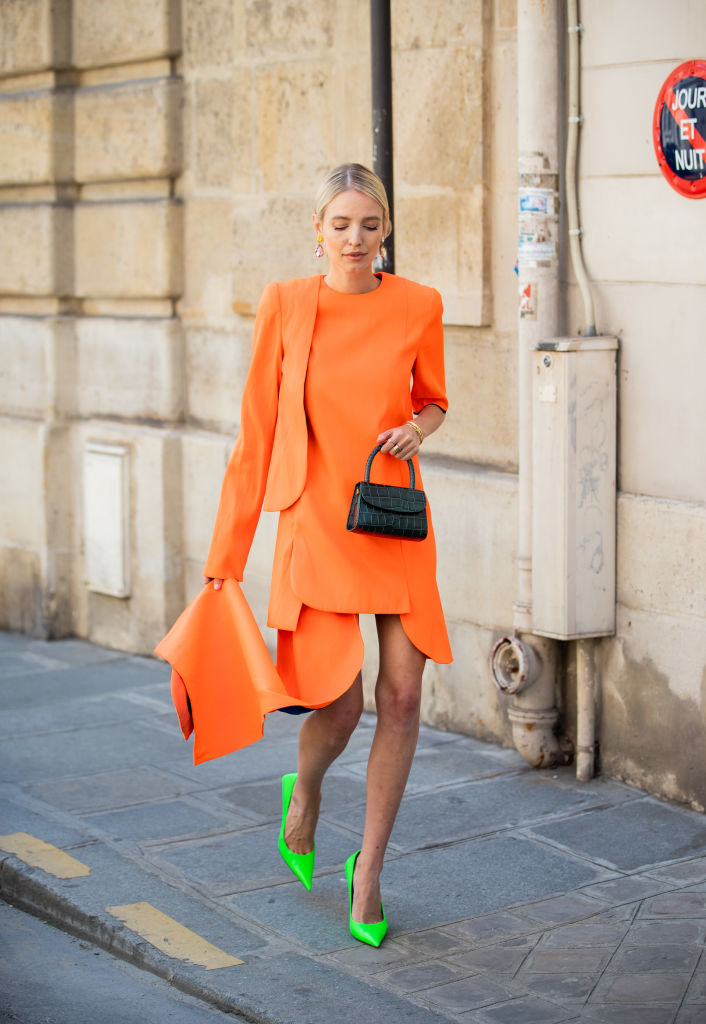 PARIS, FRANCE - JULY 03: Leonie Hanne is seen wearing orange dress, green mini bag, neon Balenciaga heels outside RVDK Ronald Van Der Kemp during Paris Fashion Week - Haute Couture Fall/Winter 2019/2020 on July 03, 2019 in Paris, France. (Photo by Christian Vierig/Getty Images)