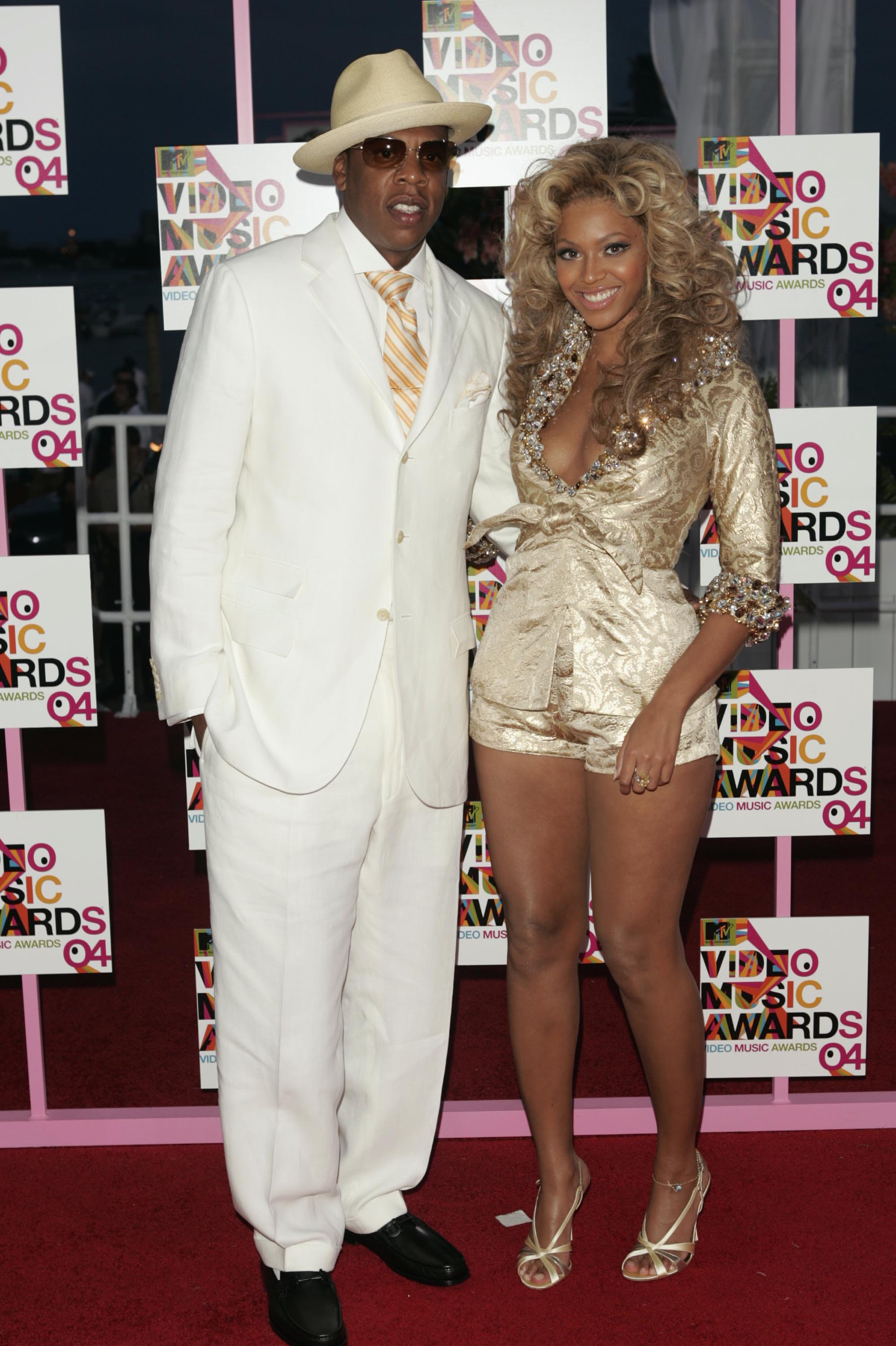 MIAMI - AUGUST 29:  Rapper/producer and nominee Jay-Z and singer Beyonce Knowles arrive at the 2004 MTV Video Music Awards at the American Airlines Arena August 29, 2004 in Miami, Florida.  (Photo by Peter Kramer/Getty Images)