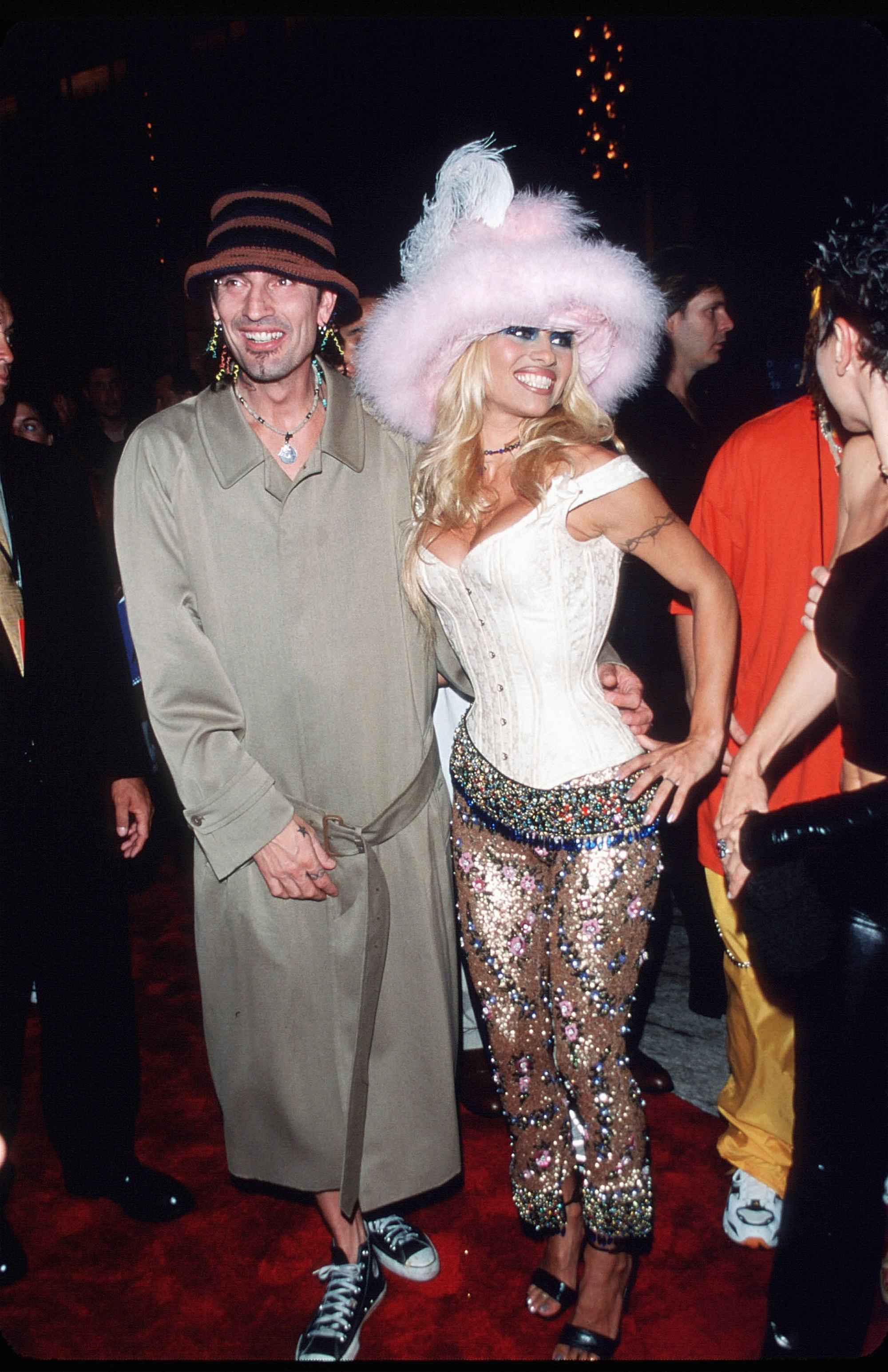 NEW YORK - SEPT 1999: Pamela Anderson poses for a picture with husband Tommy Lee on September 9, 1999 at the MTV Video Music Awards in New York City. Anderson got her start as a Playboy Playmate before moving on to Labatt's commercials, a part in Home Improvement, before starring in Baywatch. (Photo by Evan Agostini/Liaison)