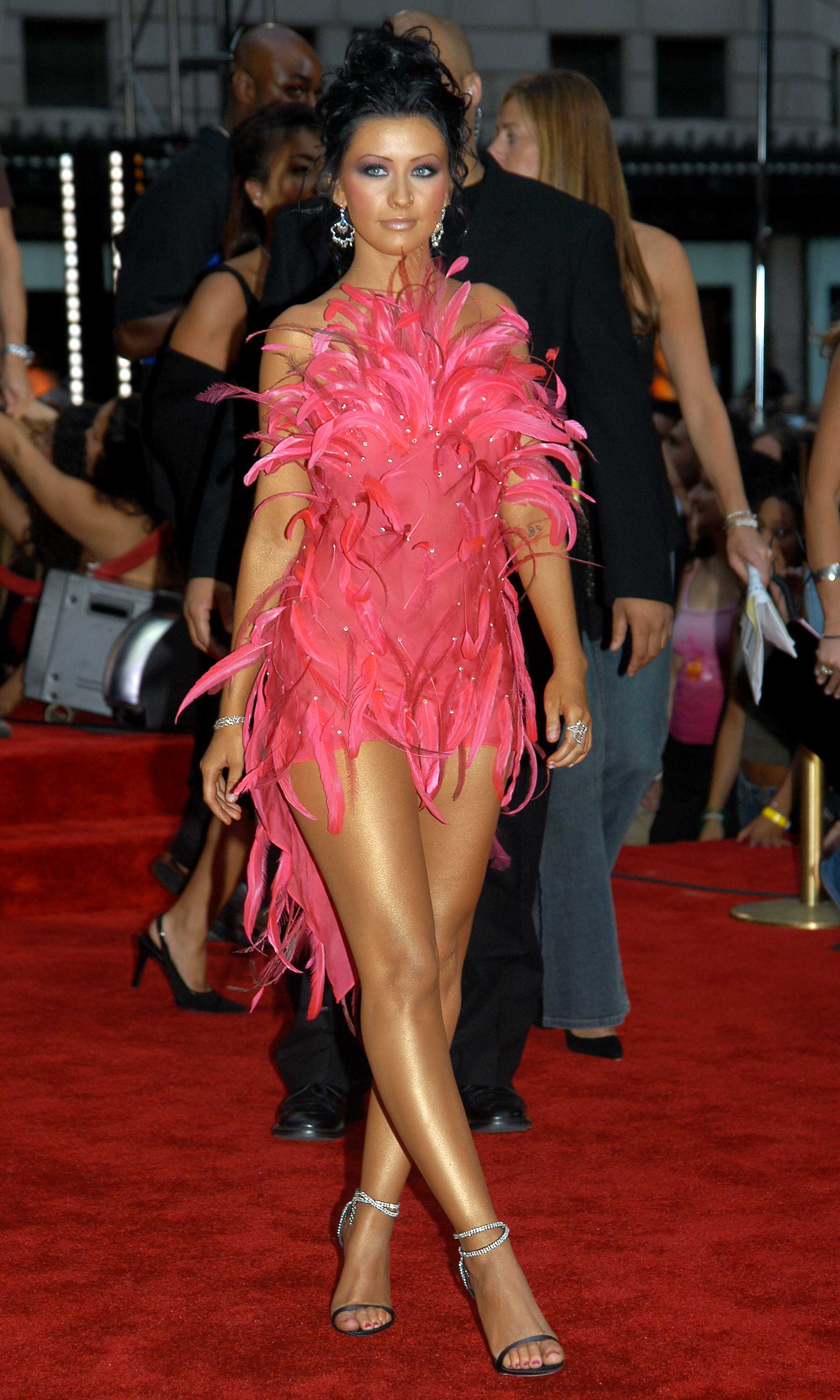 UNITED STATES - AUGUST 28:  Christina Aguilera, wearing a Roberto Cavalli minidress covered with a shock of pink feathers, arrives at Radio City Music Hall for the 2003 MTV Video Music Awards. She performed at the event.  (Photo by Richard Corkery/NY Daily News Archive via Getty Images)
