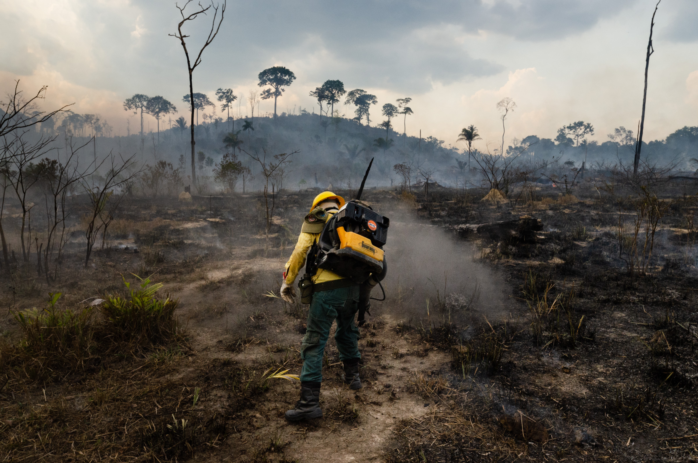 Members of the IBAMA forest fire brigade (named Prevfogo) fight burning in the Amazon area of rural settlement PDS Nova Fronteira, in the city of Novo Progresso, Para state, northern Brazil, on September 3, 2019. Since the end of August Prevfogo has been acting with the assistance of Brazilian Army military. Bolsonaro government budget cuts since January 2019 have severely affected brigades, which have been reduced in critical regions such as the Amazon. (Photo by Gustavo Basso/NurPhoto via Getty Images)